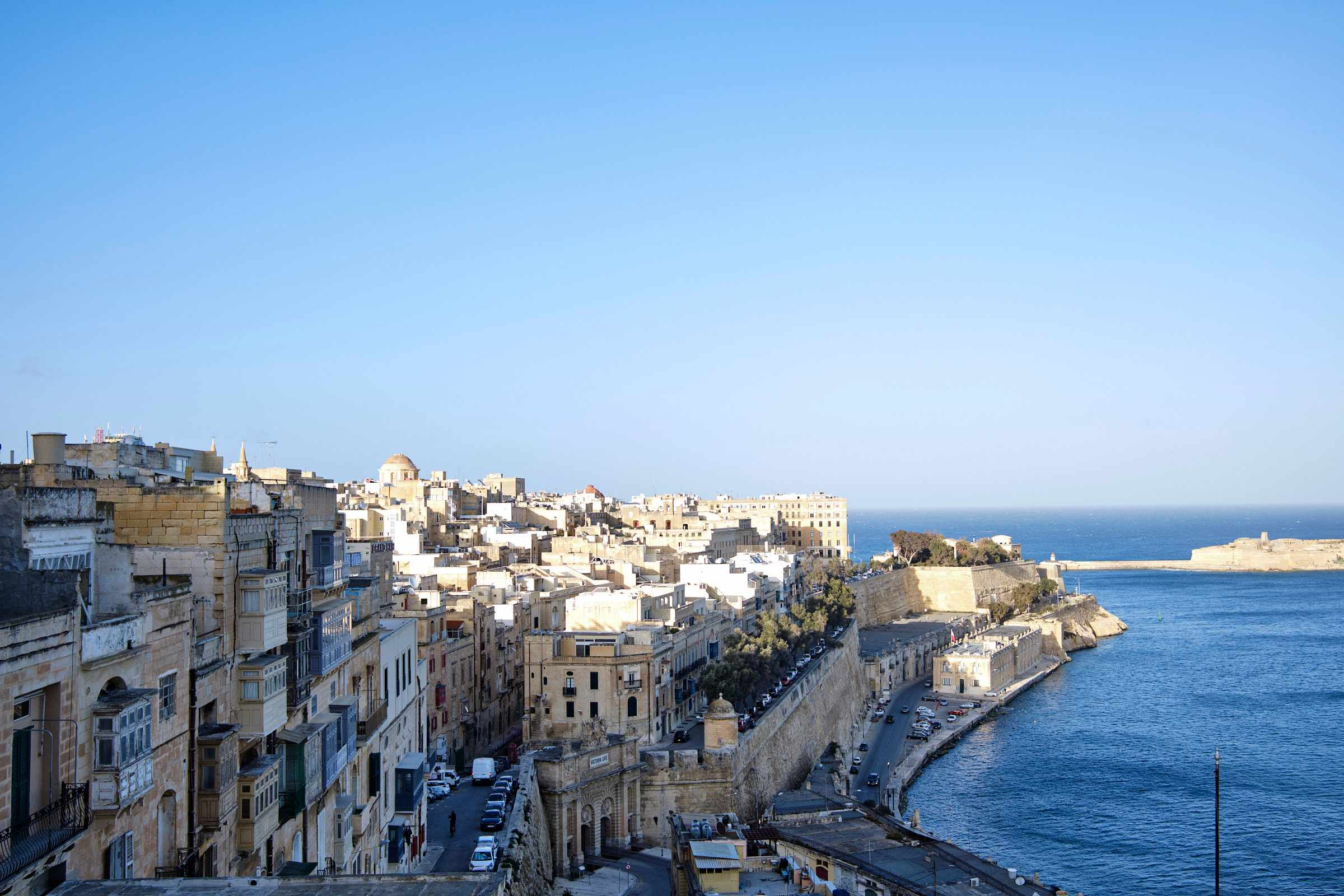 An overview of Valletta city with old buildings and the harbour