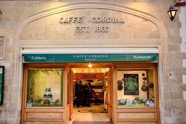 The stone building home to Caffe Cordina in Valletta. The doors are open and you can see a marble floor