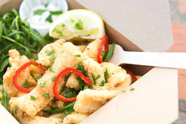 A Paper Box Filled With Crispy Squid at Cwlbox, Wales