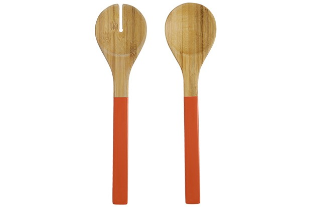 Two salad servers made from bamboo wood with orange handles