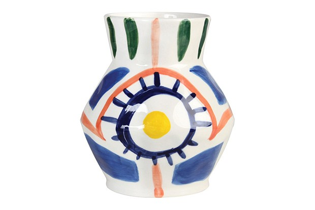 A white vase with colourful brushstroke marks on in blue, green, orange, yellow and pink