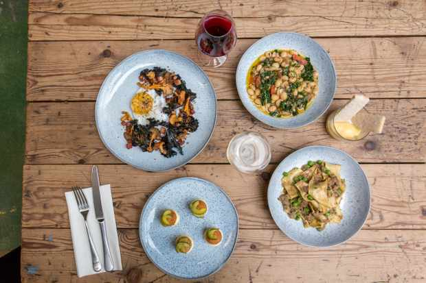 Four plates of food at Salon Brixton