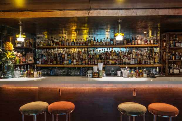 A bar lined with hundreds of bottles of rum and more at Trailer Happiness Bar Notting Hill