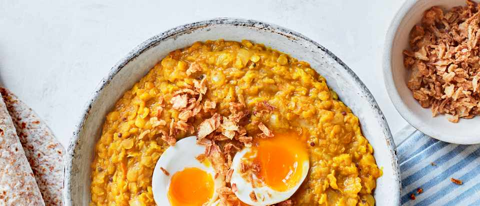 Squash and coconut dal with jammy eggs and crispy onions