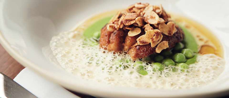 Veal sweetbread, peas, almonds and sherry cream sauce