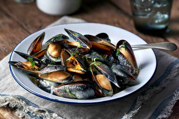 Image taken in the studio of mussels on a napkin, on rustic table for Harry Ramsden's restaurants