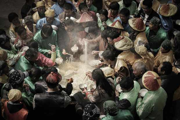 Every year from the first to eighteenth day of the lunar calendar, villagers wear Qing Dynasty costumes to celebrate Nvwa's birthday and eat big pots of noodles at noon. Shexian County, Hebei Province. County, Hebei Province, China