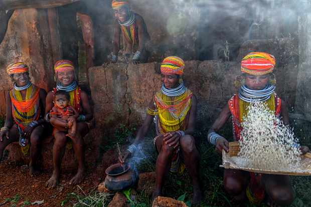 In this picture the Bonda ladies are busy preparing food in a clay pot, making fire from wood