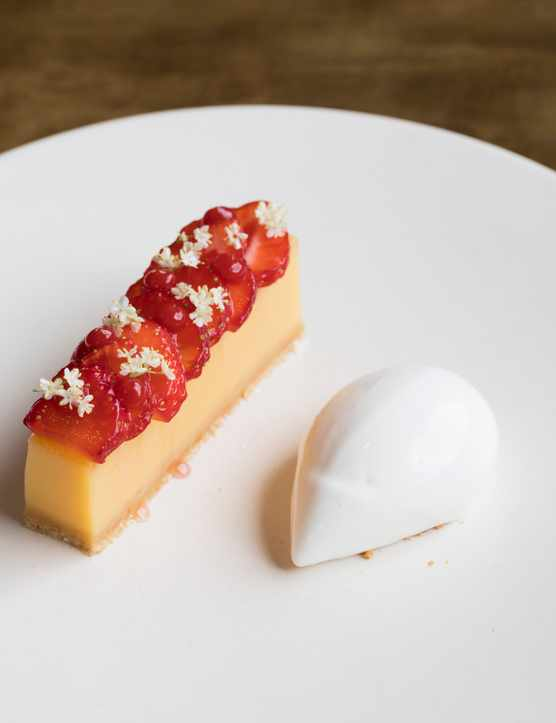 Elderflower slice with strawberries with buttermilk sorbet