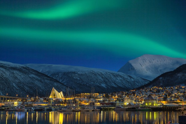 The striking green northern lights filling the sky
