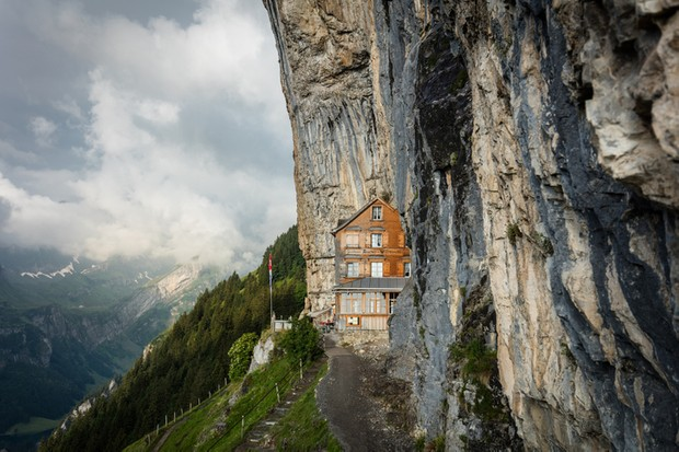 An inn perched in the rocky cliffs in the canton of Appenzell