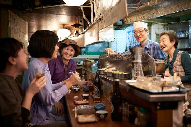 Chatting over the bar in a ramen restaurant in Tokyo