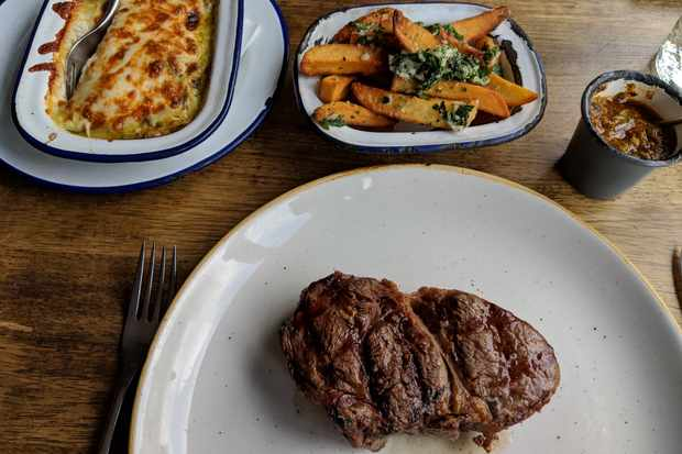 A steak and sides at Casa Malevo