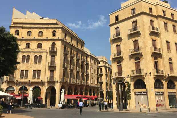 Stone-coloured tall buildings with balconies in Beirut