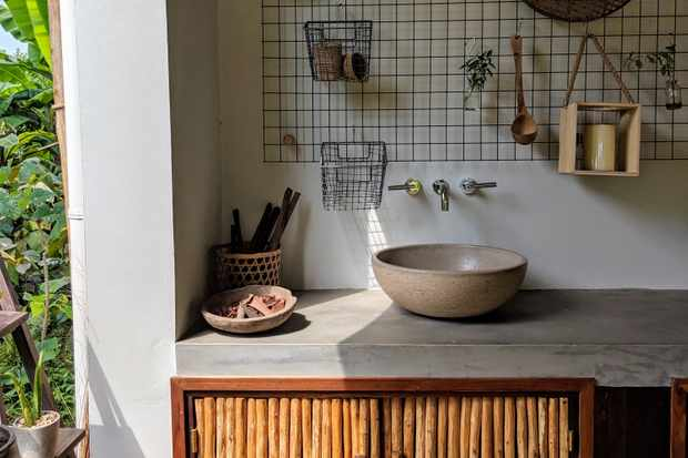 A cool concrete kitchen with wooden cabinets