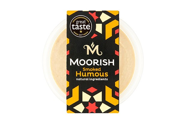 A pot of cream hummus with a black label. The label says Moorish smoked humous on the front