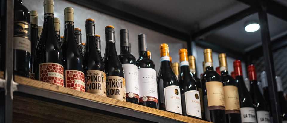 A shelf full of wine bottles