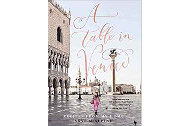 A book cover with a woman walking through an empty street in Venice
