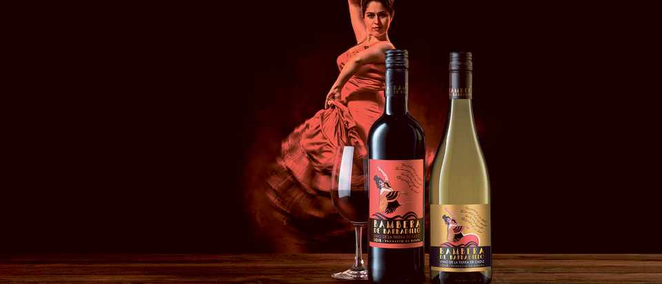 Two bottles of wine with an image of a dancer in the background