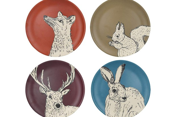 A set of four colourful plates with drawings of animals on