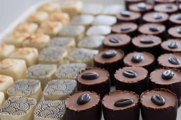 Rows of individual chocolates each decorated on top