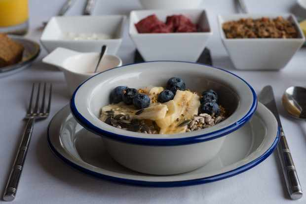 A bowl filled with banana and blueberries and oats
