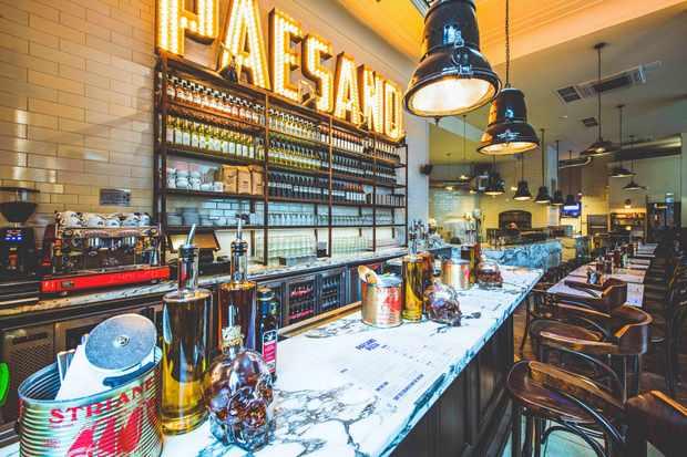 A restaurant an bar with a marble counter