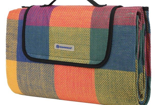 A chequered picnic blanket in orange, green and blue shades