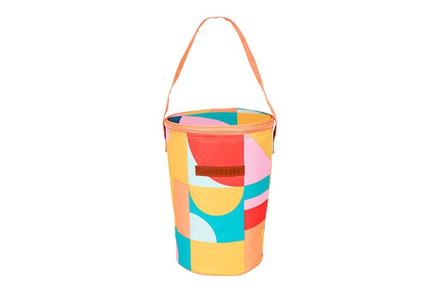 A long picnic bag with block print in yellow, red and blue with a handle