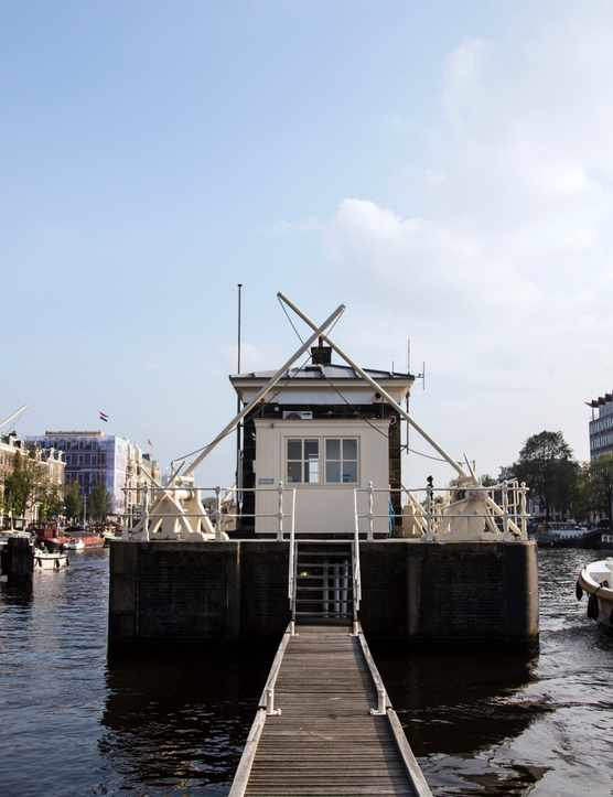 An old canal house on the river in Amsterdam