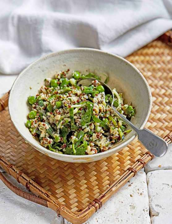 A bowl filled with grains, green beans