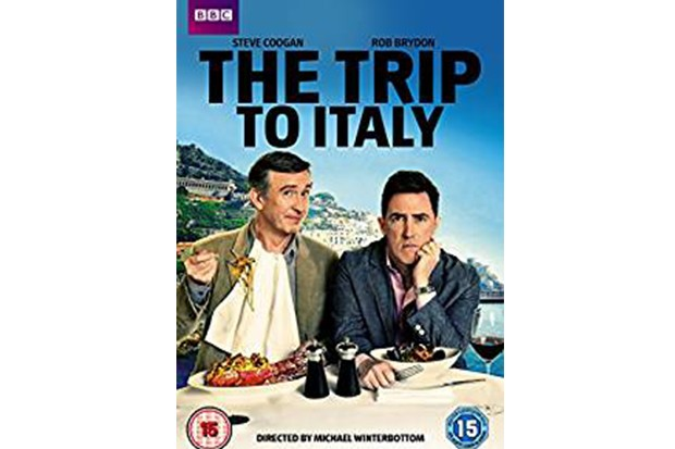 A DVD cover with an Italian landscape in the background and two men on the front sat at a table ready to eat food