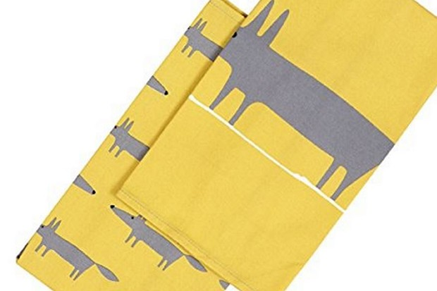 Two yellow cotton tea towels with grey dogs on