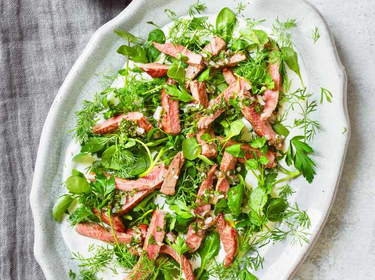 Lamb with soft herb salad and mint sauce dressing