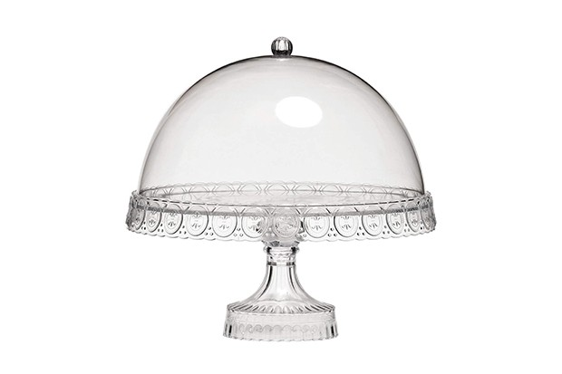 A glass cake stand with glass dome