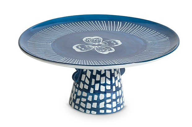 A single tier blue cake stand with white design