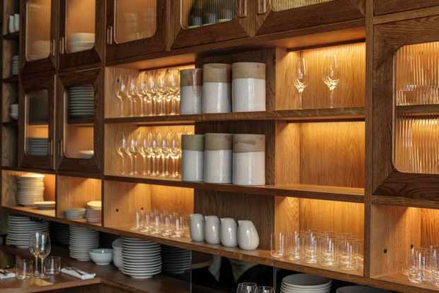 Wooden shelving units decorated with glasses