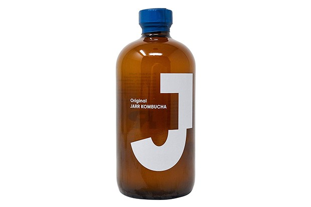 A large bottle with a blue lid and white J on