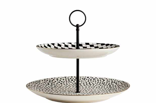 A two-tier black and white cake stand