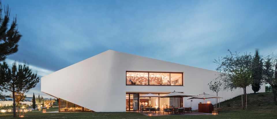 A striking white angular building against a blue sky