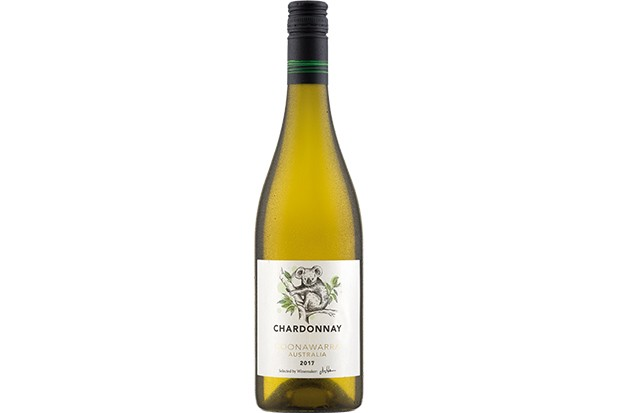 A bottle of white wine with a white label on the front