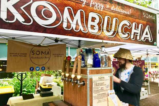 A farmers' market stall selling kombucha
