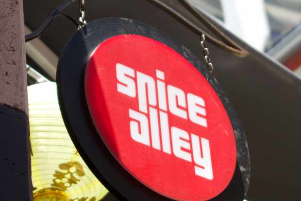 A bright red sign with white lettering that reads Spice Alley