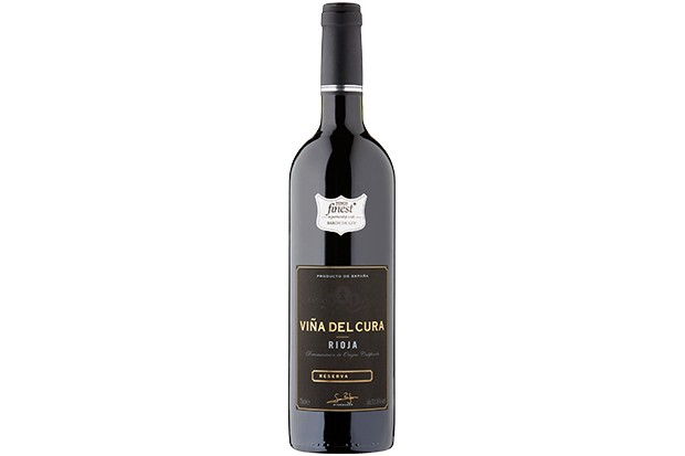 A bottle of red wine with a black label