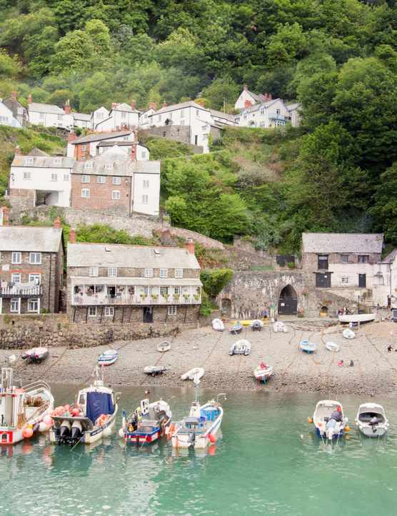 Clovelly harbour in Devon with small fishing boats