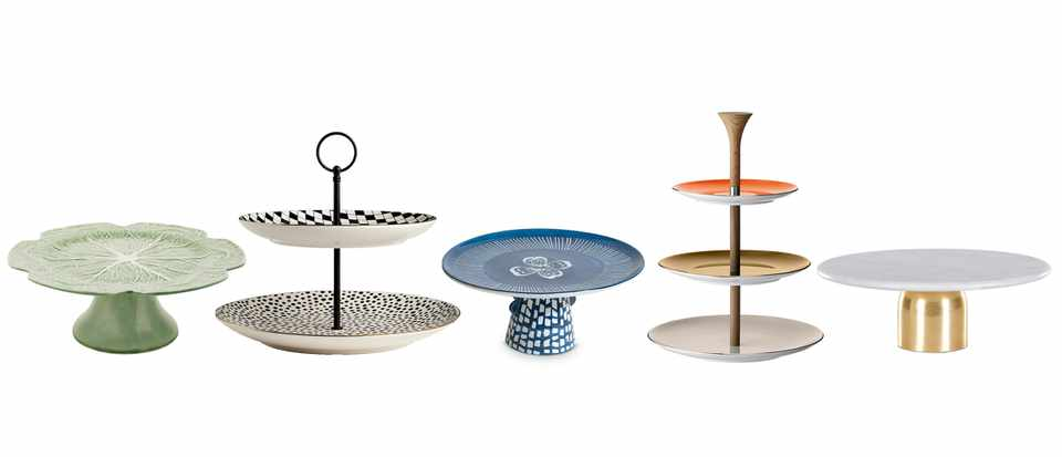 A selection of coloured cake stands in a row
