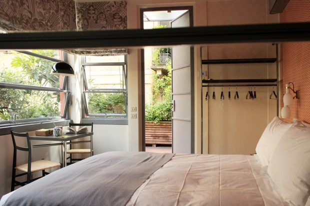 A room (dominated by a pretty bed) at La Favia urban guesthouse Milan