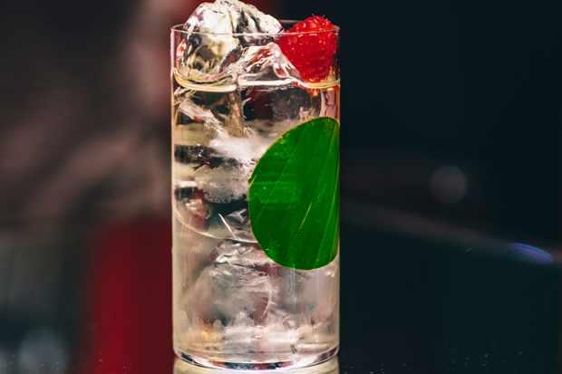 A tall glass full of clear liquid