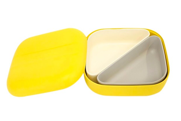 A yellow square box with grey and cream compartments