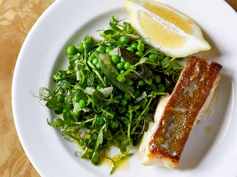 Roast cod with slow-cooked English peas and shoots